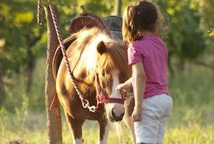 Archivio-Toscana-Promozione-Maremma-cavalli-bambina2